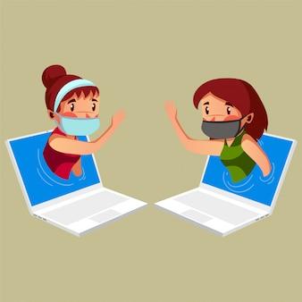 2人の若い母親が自宅での活動中にオンラインセッションを持っています