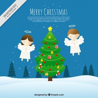 2人の天使とクリスマスツリーの背景