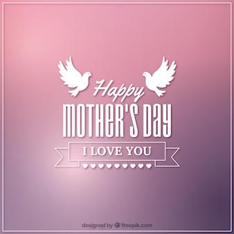 母の日のための2羽の鳩と背景をぼかした写真