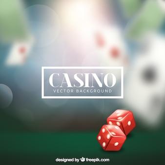 2つのサイコロとぼやけたカジノの背景