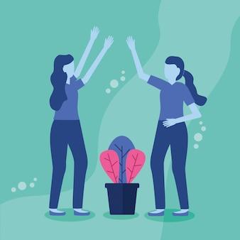 鉢植えの植物を持つ2人の女性