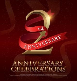 赤いリボンと2年の記念日のお祝いゴールデンロゴ