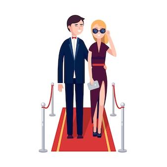 赤いカーペットを歩いている2人の有名人