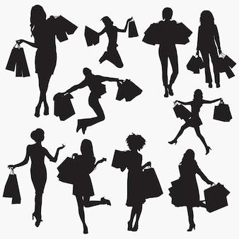 買い物袋2シルエットを持つ女性