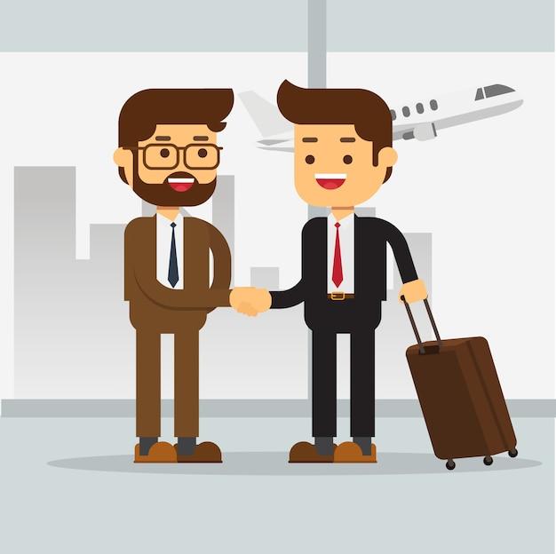 空港で2人のビジネスマンに会う