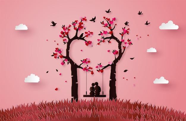 愛の木の下で夢中になっている2人のイラスト