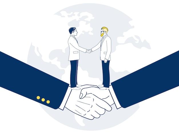 合意によって握手する2つの実業家。