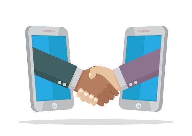 スマートフォンで2つの実業家ハンドシェイク。
