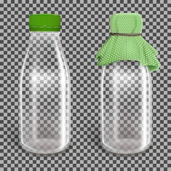 緑の紙のキャップが付いた2つのガラスの空のボトル。