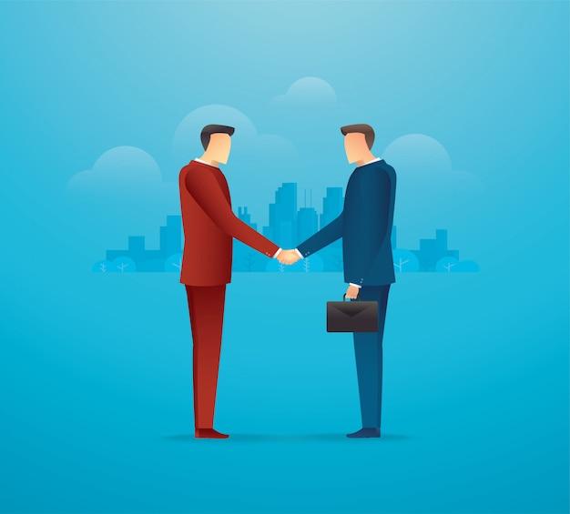 ビジネスパートナーとの出会い。握手する2人のビジネスマン