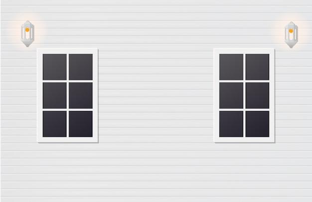 壁に2つの白い木製窓