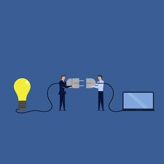 2つのビジネスマンは、アイデアとノートパソコンとケーブルで接続します。