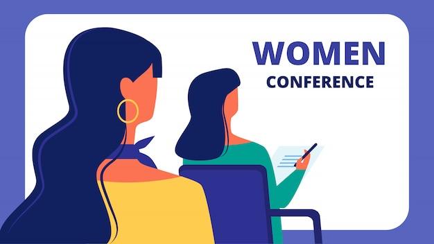 女性会議2人の女性がアセンブリホールに座っています。