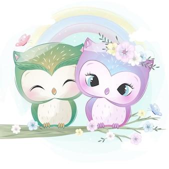 かわいい2つの小さなフクロウ