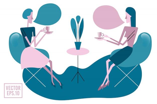 お茶を飲む2人の若い女性