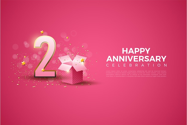 2nd anniversary with gold outlined numbers and a gift box on a pink background.