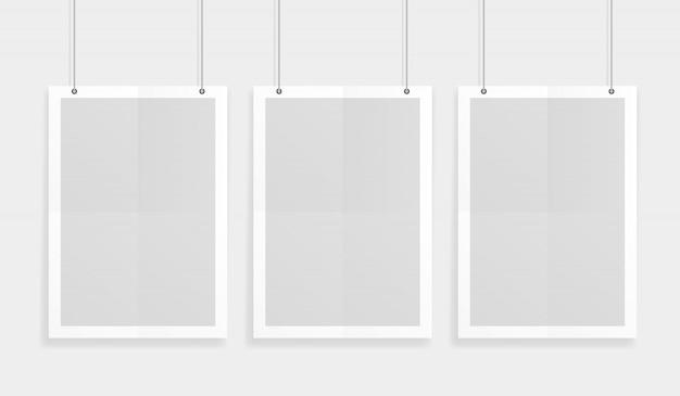 ペーパークリップでぶら下がっている空の3つの白いa4サイズのベクトル紙モックアップ。この非常に詳細な現実的なデザインテンプレート要素を使用して、チラシ、パンフレット、見出しなどを表示します。