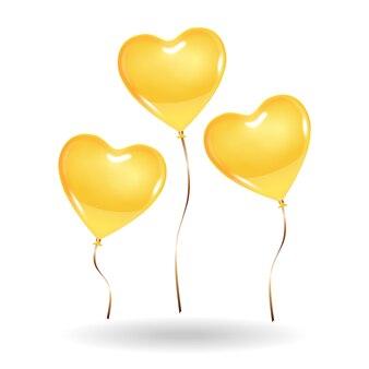 3 золотисто-желтых воздушных шара в форме сердца.
