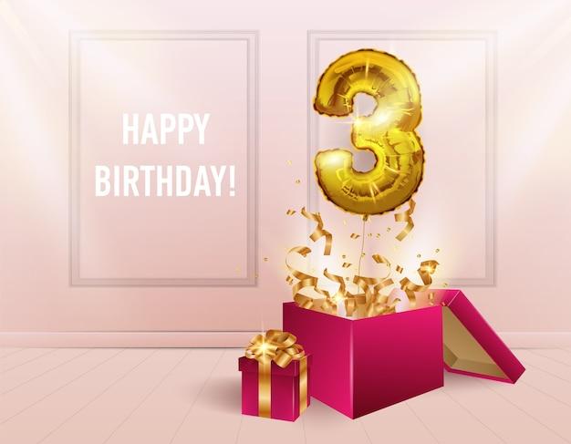 3 года с золотым шариком. празднование юбилея. из коробки вылетают воздушные шары с сверкающими конфетти, цифра 3 на фоне комнаты. день рождения девушки или свадебные украшения