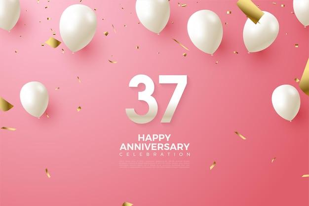 흰색 숫자와 풍선이있는 37 주년