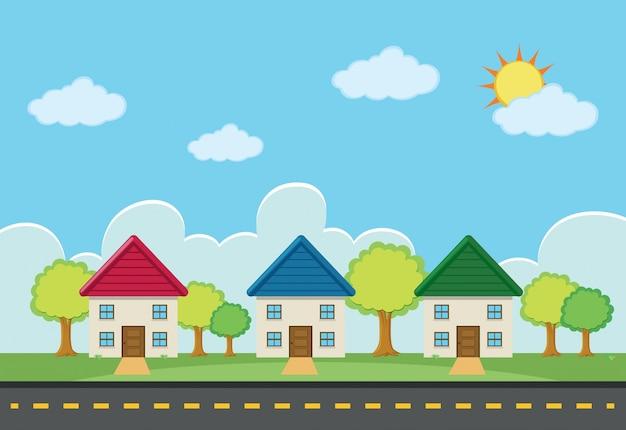 道路沿いに3つの家がある場面