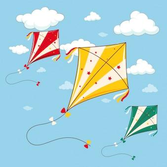 青い空の3つのカラフルな凧