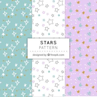 3つの手は、パステルカラーの星パターンを描いた