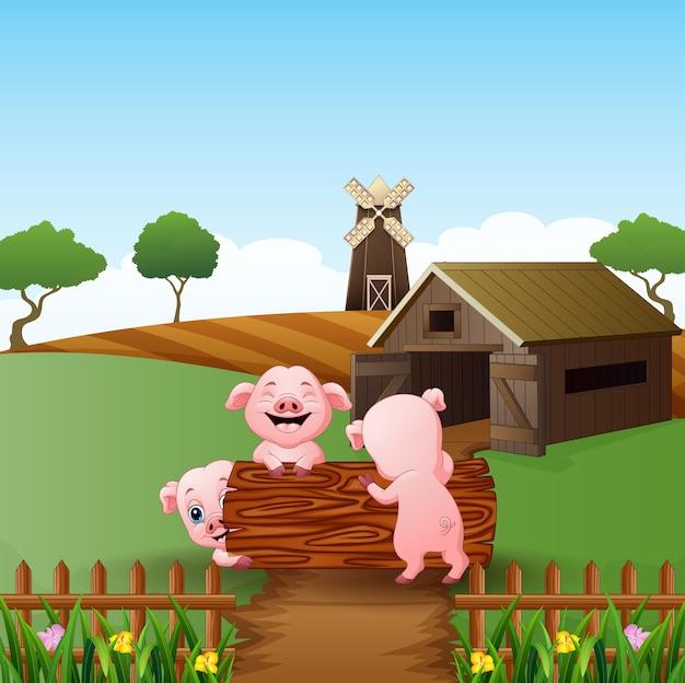 漫画3匹の小さな豚がログで遊ぶ