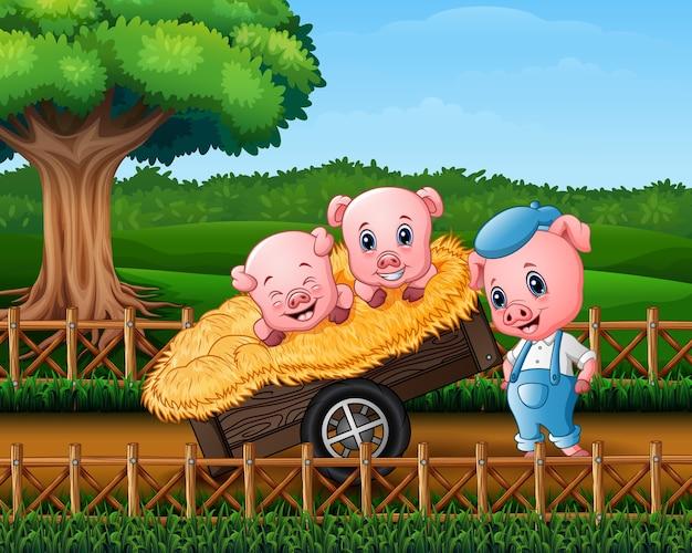 3匹の小さな豚がカートに入っています