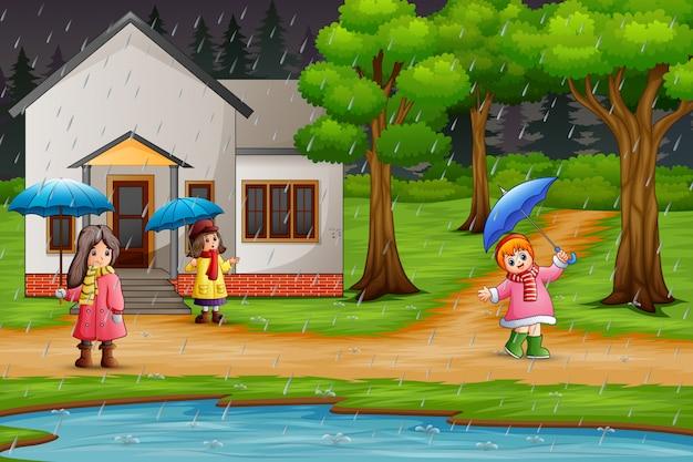 傘を運んでいる漫画の女の子3人