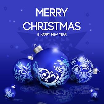 青い背景に3青いクリスマスのボール