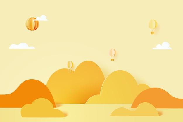 3dペーパーカット抽象的な最小限の幾何学的形状。山、雲、黄色のパステルスカイペーパーアートスタイルで飛んでいる熱風風船。図。