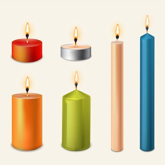 3d set realistic paraffin candles isolated on transparent.