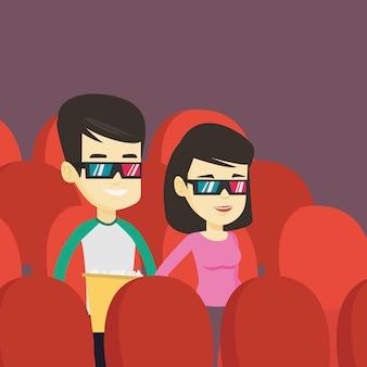 劇場で3d映画を見ている幸せな友人。