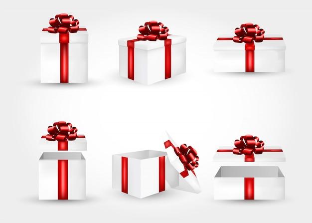 Реалистичная коллекция 3d подарочных коробок с красными атласными бантами.