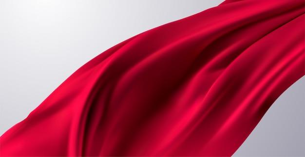 Красная шелковая ткань. 3d иллюстрации течет красный текстиль. реалистичные морщинистый занавес или флаг. абстрактный фон элемент декора для дизайна