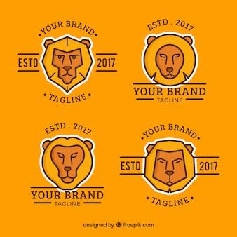 オレンジ色の背景に4つのライオンのロゴ