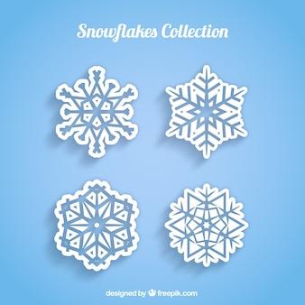 4 white snowflakes on a blue background