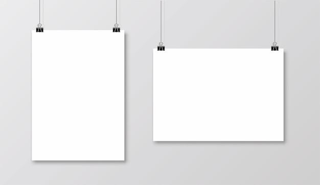 Пустая рамка формата а4, висящая на скрепке