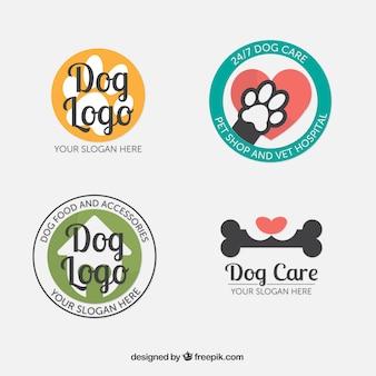 フラットなデザインの4つの幻想的な犬のロゴのセット
