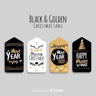 4つの黒と黄金のクリスマスのラベルのコレクション