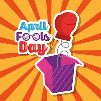 手袋4月の愚か者の日のレトロな背景といたずらボックス
