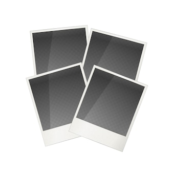 白で隔離される4つの現実的なポラロイド写真フレーム