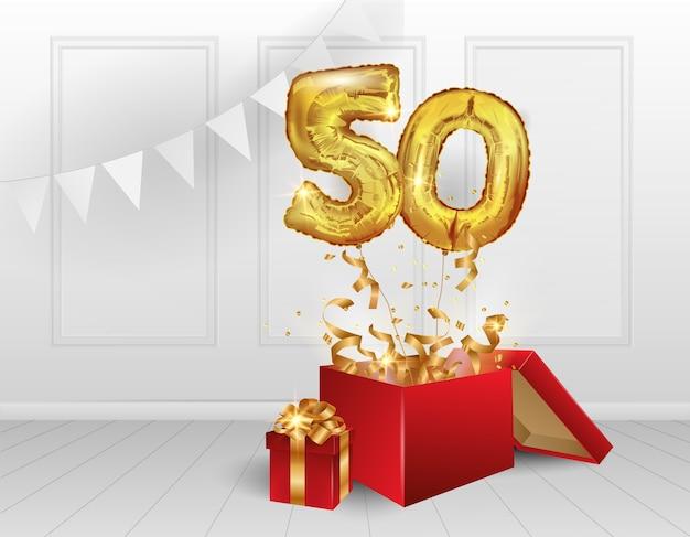 50 years of golden balloons. the celebration of the anniversary. balloons with sparkling confetti fly out of the box, number 50.
