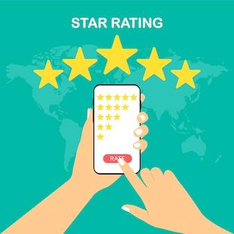 評価。 5つ星。アプリの評価。手はスマートフォンを持ち、星を評価します。