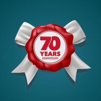 数字と赤いシールが付いた70周年記念シンボル