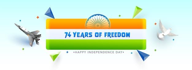 74 years of freedom independence day concept with india flag strip, fighter jet, dove flying and 3d triangle element over white and light cyan background.