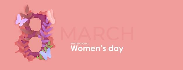 3月8日女性の日。紙から切り取った8番の中の花。