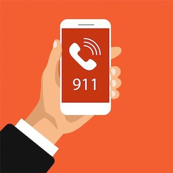 緊急通話ボタン911。画面に電話をかけると、手がスマートフォンを握ります。図。