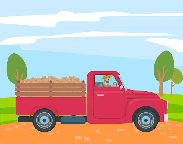 トランクでジャガイモとトラックを運転する農夫